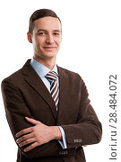 Купить «Portrait of handsome young business man standing with hands folded and smiling on white background», фото № 28484072, снято 2 февраля 2013 г. (c) Ingram Publishing / Фотобанк Лори