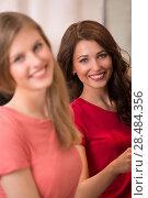 Купить «Two pretty Women shopping clothes. Shopper looking at camera indoors in store. Beautiful happy smiling caucasian females models.», фото № 28484356, снято 22 сентября 2013 г. (c) Ingram Publishing / Фотобанк Лори