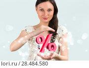 Купить «Portrait of young girl holding discount symbol in her arms», фото № 28484580, снято 17 ноября 2012 г. (c) Ingram Publishing / Фотобанк Лори