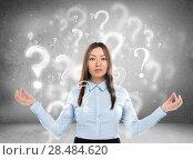 Купить «Beautiful business woman with question marks above her head», фото № 28484620, снято 16 июня 2019 г. (c) Ingram Publishing / Фотобанк Лори
