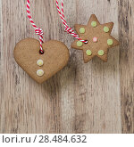 Купить «Christmas homemade gingerbread cookies over wooden table», фото № 28484632, снято 2 ноября 2012 г. (c) Ingram Publishing / Фотобанк Лори