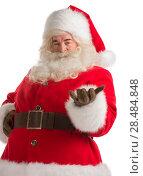 Купить «Santa Claus gesturing his hand isolated over white background. Presenting something», фото № 28484848, снято 17 января 2013 г. (c) Ingram Publishing / Фотобанк Лори