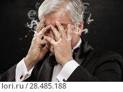 Купить «Bad Investment concept. Sad business man with currency symbols.», фото № 28485188, снято 28 января 2013 г. (c) Ingram Publishing / Фотобанк Лори