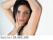 Купить «Beautiful young woman with wet hair leaning on white wall after shower or bath in bathroom», фото № 28485240, снято 7 мая 2013 г. (c) Ingram Publishing / Фотобанк Лори