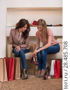 Купить «Two young attractive girlfriends go shopping», фото № 28485708, снято 22 сентября 2013 г. (c) Ingram Publishing / Фотобанк Лори
