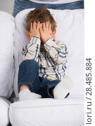 Купить «Portrait of little boy closing eyes with his hands at home», фото № 28485884, снято 31 марта 2013 г. (c) Ingram Publishing / Фотобанк Лори