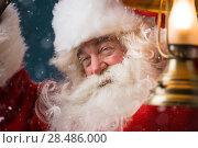 Купить «Santa Claus is holding a shining lantern while sneaking to his home outdoors at North Pole», фото № 28486000, снято 25 сентября 2013 г. (c) Ingram Publishing / Фотобанк Лори