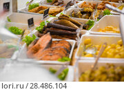 Купить «Grocery store. Different served meals on sale», фото № 28486104, снято 16 июля 2013 г. (c) Ingram Publishing / Фотобанк Лори