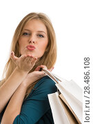 Portrait of young happy sending air kiss woman with shopping bags, isolated over white background. Стоковое фото, фотограф Kirill Kedrinskiy / Ingram Publishing / Фотобанк Лори