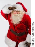 Купить «Santa Claus standing isolated on white background and looking far away - half length portrait», фото № 28486400, снято 12 января 2013 г. (c) Ingram Publishing / Фотобанк Лори