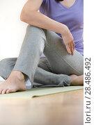 Купить «Portrait of healthy young lady practicing yoga exercise - Spine twisting pose», фото № 28486492, снято 27 ноября 2012 г. (c) Ingram Publishing / Фотобанк Лори