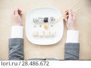 Купить «Aerial closeup of a sushi platter», фото № 28486672, снято 11 января 2012 г. (c) Ingram Publishing / Фотобанк Лори