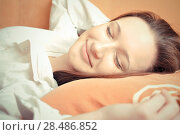 Купить «Closeup portrait of young pretty girl laying on her bed. Sleepy», фото № 28486852, снято 6 января 2011 г. (c) Ingram Publishing / Фотобанк Лори