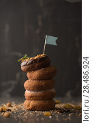 Купить «Stack of Donuts with crumbs, nuts and flag on dark stone background», фото № 28486924, снято 12 февраля 2015 г. (c) Ingram Publishing / Фотобанк Лори
