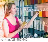 Купить «woman take a choise fresh liquid soap in perfume supermarket», фото № 28487640, снято 2 мая 2017 г. (c) Яков Филимонов / Фотобанк Лори