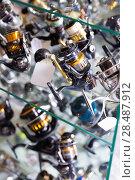 Купить «Close-up photo of variety baitcasting reel», фото № 28487912, снято 16 января 2018 г. (c) Яков Филимонов / Фотобанк Лори