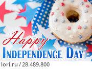 Купить «donut with star decoration on independence day», фото № 28489800, снято 28 мая 2015 г. (c) Syda Productions / Фотобанк Лори