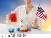 Купить «happy woman celebrating american independence day», фото № 28489804, снято 28 мая 2015 г. (c) Syda Productions / Фотобанк Лори