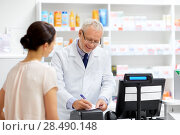 Купить «senior apothecary with prescription at pharmacy», фото № 28490148, снято 27 июня 2015 г. (c) Syda Productions / Фотобанк Лори