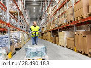 Купить «warehouse worker carrying loader with goods», фото № 28490188, снято 9 декабря 2015 г. (c) Syda Productions / Фотобанк Лори