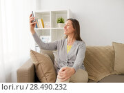 Купить «happy woman taking selfie by smartphone at home», фото № 28490232, снято 22 апреля 2017 г. (c) Syda Productions / Фотобанк Лори
