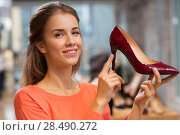 Купить «happy young woman choosing shoes at store», фото № 28490272, снято 22 сентября 2017 г. (c) Syda Productions / Фотобанк Лори