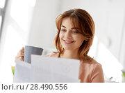 Купить «businesswoman with papers drinks coffee at office», фото № 28490556, снято 17 марта 2018 г. (c) Syda Productions / Фотобанк Лори
