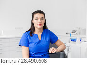Купить «female dentist or nurse at dental clinic office», фото № 28490608, снято 22 апреля 2018 г. (c) Syda Productions / Фотобанк Лори