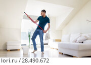 Купить «man with mop and bucket cleaning floor at home», фото № 28490672, снято 10 мая 2018 г. (c) Syda Productions / Фотобанк Лори