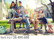 Купить «group of students with tablet pc at school yard», фото № 28490688, снято 21 мая 2016 г. (c) Syda Productions / Фотобанк Лори