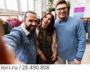 Купить «friends taking selfie at vintage clothing store», фото № 28490808, снято 30 ноября 2017 г. (c) Syda Productions / Фотобанк Лори