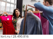 Купить «couple choosing clothes at vintage clothing store», фото № 28490816, снято 30 ноября 2017 г. (c) Syda Productions / Фотобанк Лори
