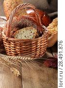 Купить «Group of bread loaves, buns, rolls on the wooden table», фото № 28491876, снято 13 ноября 2012 г. (c) Ingram Publishing / Фотобанк Лори