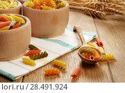 Купить «Raw tricolor pasta set on the wooden table», фото № 28491924, снято 13 января 2013 г. (c) Ingram Publishing / Фотобанк Лори