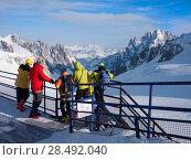 Купить «Skiers looking at view: Vallèe Blanche Glacier, Chamonix, France», фото № 28492040, снято 20 июня 2019 г. (c) Ingram Publishing / Фотобанк Лори