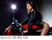 Купить «Young sexy woman sitting on motorcycle», фото № 28492120, снято 20 июня 2018 г. (c) Ingram Publishing / Фотобанк Лори