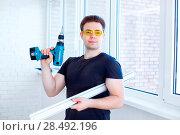 Купить «Man worker after installing new windows», фото № 28492196, снято 22 мая 2019 г. (c) Ingram Publishing / Фотобанк Лори