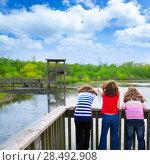 Купить «Kid children girls looking and pointing at park lake in Texas rear view», фото № 28492908, снято 22 октября 2018 г. (c) Ingram Publishing / Фотобанк Лори