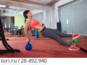 Купить «Crossfit fitness woman push ups with Kettlebell rear pushup exercise», фото № 28492940, снято 19 апреля 2019 г. (c) Ingram Publishing / Фотобанк Лори