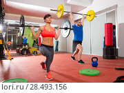 Купить «Crossfit fitness gym weight lifting bar by woman and man group workout», фото № 28493156, снято 19 марта 2019 г. (c) Ingram Publishing / Фотобанк Лори