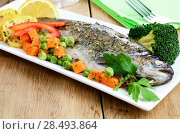 Купить «Dish with baked trout and vegetables on the kitchen table», фото № 28493864, снято 27 июня 2019 г. (c) Ingram Publishing / Фотобанк Лори