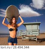 Купить «Brunette surfer teen girl holding surfboard in Santa Monica beach California», фото № 28494344, снято 20 июня 2019 г. (c) Ingram Publishing / Фотобанк Лори