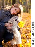 Купить «Young woman with favorite dog», фото № 28494656, снято 6 октября 2013 г. (c) Ingram Publishing / Фотобанк Лори