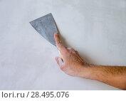 Купить «Plastering man hand with plaste and plaster spatula trowel in wall», фото № 28495076, снято 12 февраля 2013 г. (c) Ingram Publishing / Фотобанк Лори