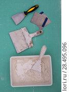Купить «Platering tools for plaster like plaste trowel spatula on green drywall plasterboard», фото № 28495096, снято 10 марта 2013 г. (c) Ingram Publishing / Фотобанк Лори