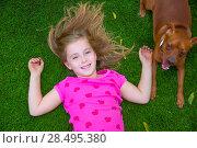 Купить «Beautiful blond kid children girl smiling relaxed lying on grass backyard lawn», фото № 28495380, снято 15 октября 2013 г. (c) Ingram Publishing / Фотобанк Лори