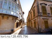 Ciutadella Menorca Placa de Alfons III in Ciudadela downtown in Balearic islands (2013 год). Стоковое фото, фотограф Tono Balaguer / Ingram Publishing / Фотобанк Лори