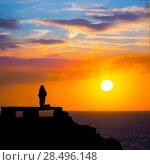 Купить «Ciutadella Menorca at Punta Nati orange sunset with girl backlight», фото № 28496148, снято 24 мая 2013 г. (c) Ingram Publishing / Фотобанк Лори