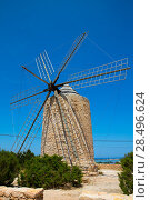 Купить «Formentera Windmill wind mill vintage masonry and wood in Mediterranean Balearic islands», фото № 28496624, снято 16 октября 2018 г. (c) Ingram Publishing / Фотобанк Лори