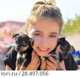 Купить «Kid girl playing with puppy dogs smiling with blue eyes», фото № 28497056, снято 21 сентября 2013 г. (c) Ingram Publishing / Фотобанк Лори